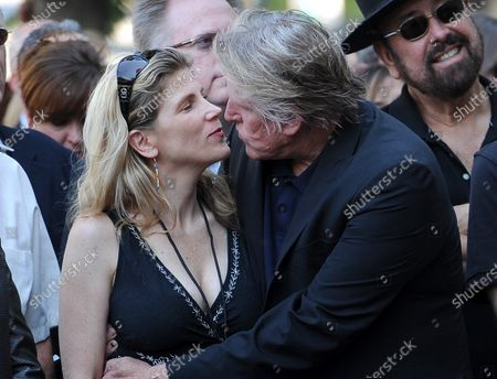 The late Buddy Holly received a posthumous Walk of Fame Star on his 75th birthday on Vine Street in front of The Capitol Records Building in Los Angeles on September 7, 2011.  Stephanie and Gary Busey share a moment during the ceremony .