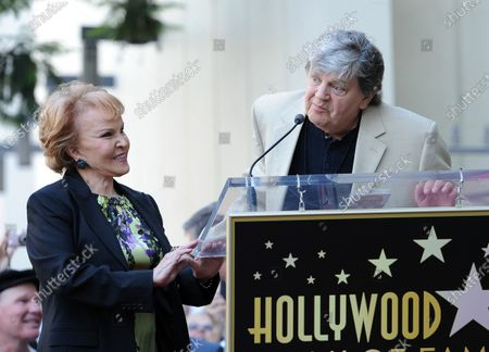 The late Buddy Holly received a posthumous Walk of Fame Star on his 75th birthday on Vine Street in front of The Capitol Records Building in Los Angeles on September 7, 2011.  His widow, Maria Elena Holly who made a rare appearance at the event, listens as Phil Everly says a few words.
