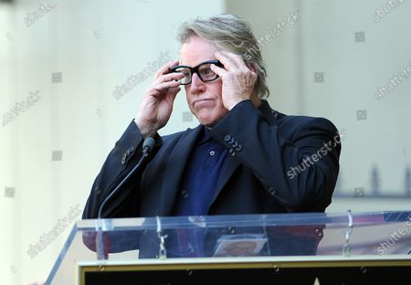 """Stock Image of The late Buddy Holly received a posthumous star on Hollywood's Walk of Fame on his 75th birthday on Vine Street in front of The Capitol Records Building in Los Angeles on September 7, 2011. His widow, Maria Elena Holly who made a rare appearance at the event, listens as Gary Busey puts on """"Buddy Holly"""" style glasses and says a few words. Busey starred as Holly in the move The Buddy Holly Story."""