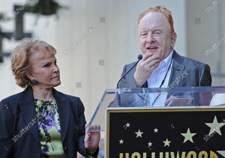 Stock Photo of The late Buddy Holly received a posthumous star on Hollywood's Walk of Fame on his 75th birthday on Vine Street in front of The Capitol Records Building in Los Angeles on September 7, 2011. His widow, Maria Elena Holly who made a rare appearance at the event, listens as record producer Peter Asher says a few words.