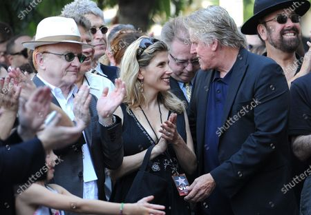 The late Buddy Holly received a posthumous Walk of Fame Star on his 75th birthday on Vine Street in front of The Capitol Records Building in Los Angeles on September 7, 2011.  Peter Asher (with hat) and Stephanie and Gary Busey share a moment during the ceremony .