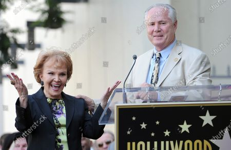 Stock Picture of The late Buddy Holly received a posthumous star on Hollywood's Walk of Fame on his 75th birthday on Vine Street in front of The Capitol Records Building in Los Angeles on September 7, 2011. His widow, Maria Elena Holly claps as Los Angeles City Councilman Tom LaBonge declared it Buddy Holly day in Los Angeles.
