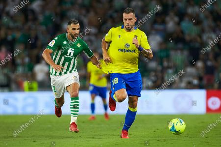 Martin Montoya of Real Betis and Alvaro Negredo of Cadiz