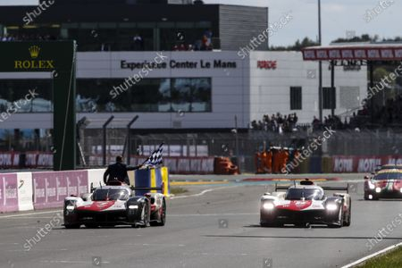 CIRCUIT DE LA SARTHE, FRANCE - AUGUST 22: #7 Toyota Gazoo Racing Toyota GR010 - Hybrid Hypercar of Mike Conway, Kamui Kobayashi, Jose Maria Lopez and #8 Toyota Gazoo Racing Toyota GR010 - Hybrid Hypercar of Sebastien Buemi, Kazuki Nakajima, Brendon Hartley during the 24 Hours of Le Mans at the Circuit de la Sarthe on August 22, 2021 in Le Mans, France. (Photo by JEP / LAT Images)