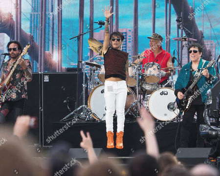 Deen Castroban (drums) Arnel Pineda and Neal Scion of Journey perform onstage during We Love NYC: The Homecoming Concert Produced by NYC, Clive Davis, and Live Nation