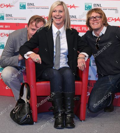 """Stephan Elliott (L), Olivia Newton-John (C) and Kris Marshall arrive at a photocall for the film """"A Few Best Men"""" during the 6th Rome International Film Festival in Rome on October 28, 2011."""