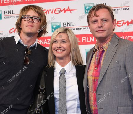 """Stock Picture of Kris Marshall (L), Olivia Newton-John (C) and Stephan Elliott arrive at a photocall for the film """"A Few Best Men"""" during the 6th Rome International Film Festival in Rome on October 28, 2011."""