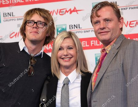 """Stock Image of Kris Marshall (L), Olivia Newton-John (C) and Stephan Elliott arrive at a photocall for the film """"A Few Best Men"""" during the 6th Rome International Film Festival in Rome on October 28, 2011."""