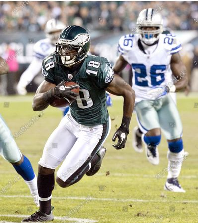 Philadelphia Eagles wide receiver Jeremy Maclin leads the way as he carries to the Dallas Cowboys 12-yard line during first quarter Dallas Cowboys-Philadelphia Eagles game action at Lincoln Financial Field October 30, 2011 . Maclin scored for the Eagles on the next play. Trailing is Dallas Cowboys Abram Elam.