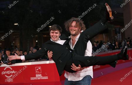 """Vincent Lannoo carries Cameron Bright on the red carpet before a screening of the film """"Little Glory"""" during the 6th Rome International Film Festival in Rome on October 31, 2011."""