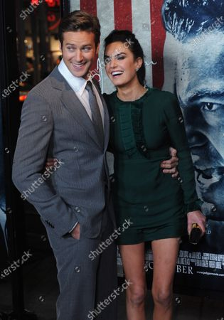 """Armie Hammer, a cast member in the motion picture biographical drama """"J. Edgar"""", attends the premiere of the film with Elizabeth Chambers at Grauman's Chinese Theatre in the Hollywood section of Los Angeles on November 3, 2011."""