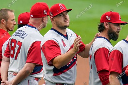 Los Angeles Angels Mike Trout, center, lines up during team introductions before the Little League Classic baseball game against the Cleveland Indians at Bowman Stadium in Williamsport, Pa., . Trout did not play in the 3-0 loss to the Indians