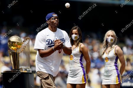 New Los Angeles Lakers NBA player Russell Westbrook is introduced prior to throwing out a first ceremonial pitch before a baseball game between the Los Angeles Dodgers and the New York Mets in Los Angeles
