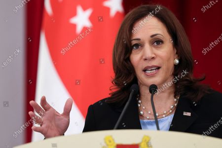Vice President Kamala Harris attends a joint news conference with Singapore's Prime Minister Lee Hsien Loong in Singapore