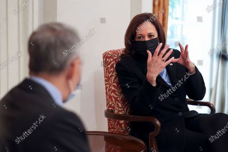 Vice President Kamala Harris, right, and Singapore's Prime Minister Lee Hsien Loong hold a meeting in Singapore