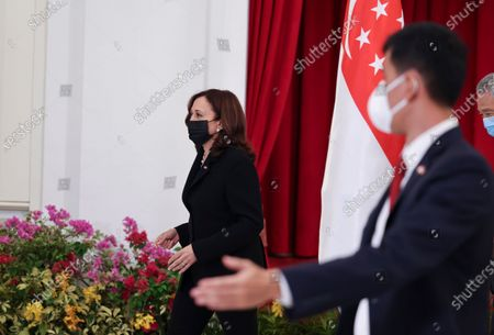 Vice President Kamala Harris and Singapore's Prime Minister Lee Hsien Loong, far right, attend a meeting in Singapore
