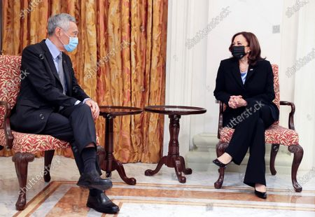 Stock Photo of Vice President Kamala Harris, right, and Singapore's Prime Minister Lee Hsien Loong hold a meeting in Singapore