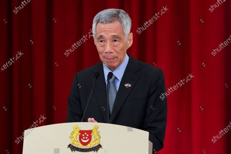 Singapore's Prime Minister Lee Hsien Loong attends a joint news conference with U.S. Vice President Kamala Harris in Singapore