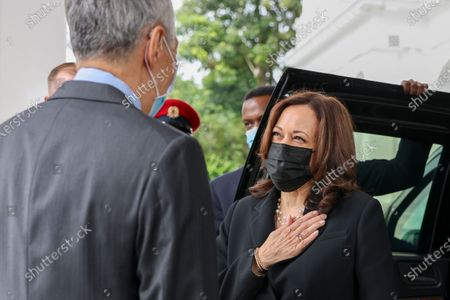 Vice President Kamala Harris, right, is welcomed by Singapore's Prime Minister Lee Hsien Loong at the Istana in Singapore