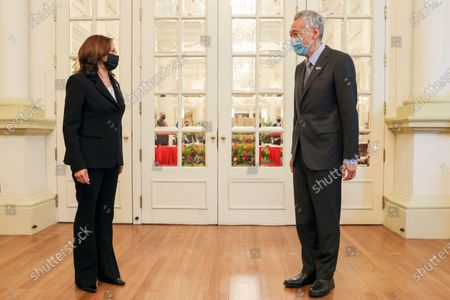 Vice President Kamala Harris, left, stands next to Singapore's Prime Minister Lee Hsien Loong before their bilateral meeting at the Istana in Singapore