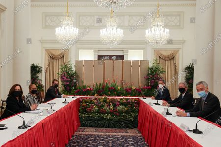 Vice President Kamala Harris, left, meets Singapore's Prime Minister Lee Hsien Loong, right, in a bilateral meeting at the Istana in Singapore