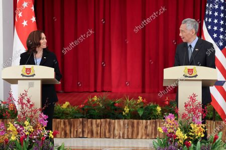 Vice President Kamala Harris, left, and Singapore's Prime Minister Lee Hsien Loong hold a joint news conference in Singapore