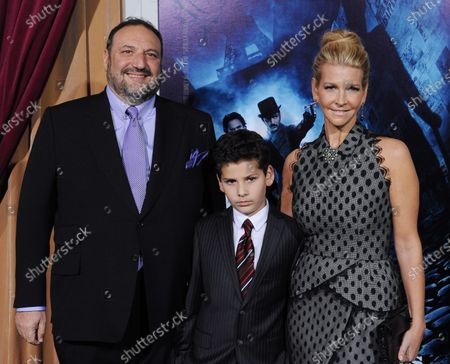 """Producer Joel Silver attends the premiere of the motion picture mystery thriller """"Sherlock Holmes: A Game of Shadows"""", with his wife Karyn Fields and their son Max at the Village Theatre in the Westwood section of Los Angeles on December 6, 2011."""