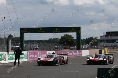 CIRCUIT DE LA SARTHE, FRANCE - AUGUST 22: #7 Toyota Gazoo Racing Toyota GR010 - Hybrid Hypercar of Mike Conway, Kamui Kobayashi, Jose Maria Lopez and #8 Toyota Gazoo Racing Toyota GR010 - Hybrid Hypercar of Sebastien Buemi, Kazuki Nakajima, Brendon Hartley during the 24 Hours of Le Mans at the Circuit de la Sarthe on August 22, 2021 in Le Mans, France. (Photo by LAT Images)