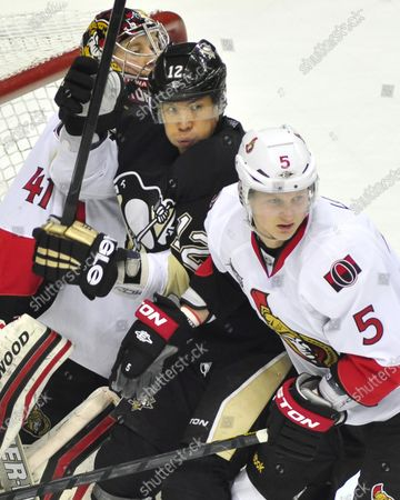 Pittsburgh Penguins Richard Park receives a goal tender interference call as he is caught between  Ottawa Senators goalie Craig Anderson and Senators Brain Lee in the second period at Consol Energy Center in Pittsburgh, Pennsylvania on January 10, 2012.