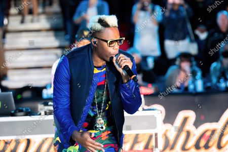 Stock Picture of Canadian rapper Jason Drew Harrow, better known by his stage name Kardinal Offishall performs during the half time show at Canadian Elite Basketball Season Final between Edmonton Stingers and Niagara River Lions at the Edmonton Expo Center.