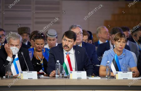President of Finland Sauli Niinisto, left, Hungarian President Janos Ader, center, and Estonian President Kersti Kaljulaid attend the Crimean Platform Summit in Kyiv, Ukraine, . The Crimean Platform, an international summit called by Ukraine to build up pressure on Russia over the annexation that has been denounced as illegal by most of the world, opened in Kyiv on Monday