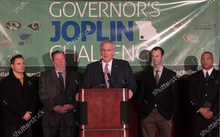 Stock Image of With represenatives from the St. Louis Cardinals, St. Louis Blues and St. Louis Rams standing near, Missouri Governor Jay Nixon outlines the new Governor's Joplin Challenge, in St. Louis on February 10, 2012.  The challenge, in partnership with Joplin Area Habitat for Humanity and Missouri's major athletic organizations, aims to build 35 new homes in the heart of Joplin during 2012 to provide continued aid to the city's recovery. Joplin was hit by a May 22, 2011 tornado that killed 161 people and destroyed over 7000 homes.