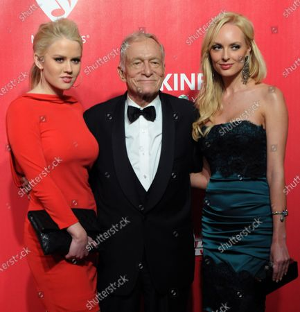 Kristina Shannon, Hugh Hefner and Karissa Shannon (L-R) arrive for the MusiCares Person of the Year Tribute to Paul McCartney held at the Los Angeles Convention Center in Los Angeles on February 10, 2012.