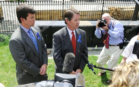 Chris Jones (L) and Keith Jones (R), brother and father of Gordon Jones respectively, talk to reporters outside the West Wing of the White House  in Washington on June 10, 2010. Family members of those killed on the Deepwater Horizon oil rig attended a meeting with President Barack Obama.