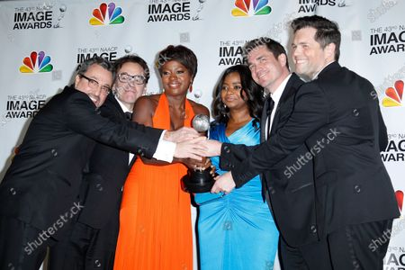 (L-R) Producers Michael Barnathan, Chris Columbus, actresses Viola Davis, Octavia Spencer and producers Tate Taylor and Brunson Green hold the award for Outstanding Motion Picture for 'The Help' in the press room at the 43rd NAACP Image Awards at the Shrine Auditorium in Los Angeles on February 17, 2012.