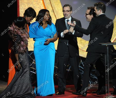 """Actresses Cicely Tyson, Viola Davis and Octavia Spencer, producers Tate Taylor, Michael Barnathan, Brunson Green and Chris Columbus accept the award for Outstanding Motion Picture for """"The Help"""" onstage during the 43rd NAACP Image Awards,held at the Shrine Auditorium in Los Angeles on February 17, 2012."""