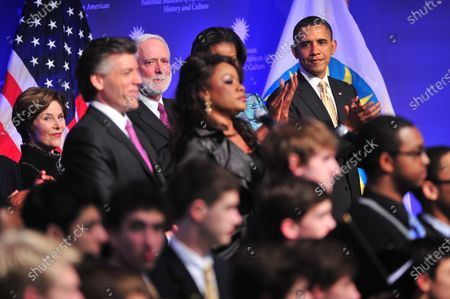 President Barack Obama stands alongside Denyce Graves as she performs at the ground breaking ceremony for the Smithsonian National Museum of African American History and Culture in Washington, D.C. on February 22, 2012. The museum is set to open in 2015.