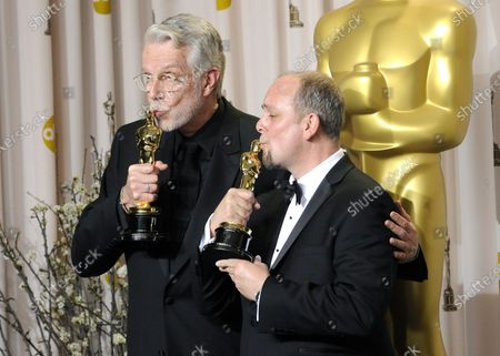 """Mark Coulier and J. Roy Helland hold their Oscars for Achievement in Makeup for """"The Iron Lady"""" backstage during the 84th Academy Awards in the Hollywood section of Los Angeles on February 26, 2012."""