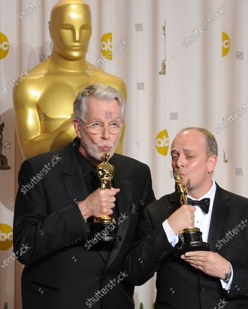 Mark Coulier and J. Roy Helland kiss their Oscars for Makeup while backstage at the 84th Academy Awards at the Hollywood and Highlands Center in Los Angeles on February 26, 2012.