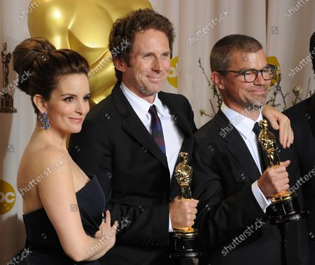 Tina Fey presents Kirk Baxter and Angus Wall as they hold their Oscars for Film Editing for the movie, The Girl with Dragon Tattoo while backstage with for the 84th Academy Awards at the Hollywood and Highlands Center in Los Angeles on February 26, 2012.