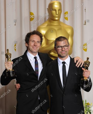 Kirk Baxter and Angus Wall hold their Film Editing Oscars while backstage for the 84th Academy Awards at the Hollywood and Highlands Center in Los Angeles on February 26, 2012.