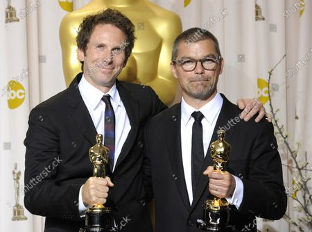 """Kirk Baxter and Angus Wall pose with their Oscar for Achievement in Film Editing for """"The Girl with Dragon Tattoo"""" backstage during the 84th Academy Awards in the Hollywood section of Los Angeles on February 26, 2012."""