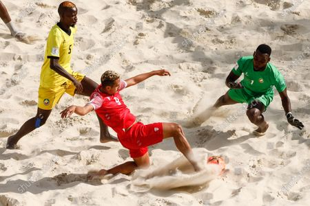 Heirauarii Salem (C) of Tahiti scores a goal past Tivane (R) and Big Roo of Mozambique during the FIFA Beach Soccer World Cup Russia 2021 Group D match between Tahiti and Mozambique on August 23, 2021 at Luzhniki Beach Soccer Stadium in Moscow, Russia.