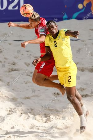 Heirauarii Salem (L) of Tahiti and Bachir of Mozambique vie for a header during the FIFA Beach Soccer World Cup Russia 2021 Group D match between Tahiti and Mozambique on August 23, 2021 at Luzhniki Beach Soccer Stadium in Moscow, Russia.
