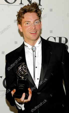 Levi Kreis posed with his award for Best Performance by a Featured Actor in a Musical at the 64th Annual Tony Awards at The Sports Club/LA on June 13, 2010 in New York City.