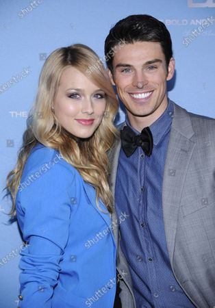 """Cast member Adam Gregory (R) and guest attend """"The Bold and the Beautiful"""" 25th Silver Anniversary Party in Los Angeles on March 10, 2012."""