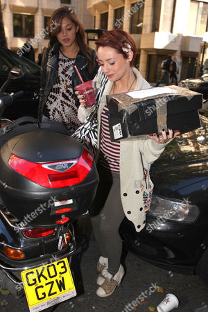 Geneva Lane and Rebecca Creighton of Belle Amie squeezing between a motorcycle and a car