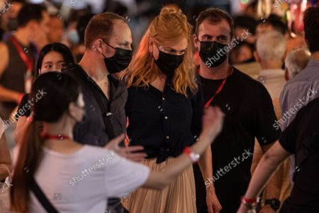 Nicole Kidman (C) is escorted out of the set after filming a scene for the Amazon Prime series 'Expats' in Mongkok district, Hong Kong, China, 23 August 2021. Kidman arrived in Hong Kong on 19 August and sparked outrage among many groups as she and her entourage were exempted from serving mandatory COVID-19 quarantine by the government  'for the purpose of performing designated professional work, taking into account that it is conducive to maintaining the necessary operation and development of Hong Kong's economy.'