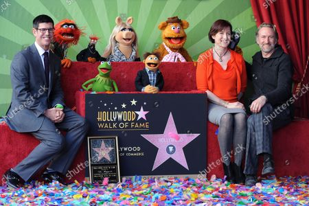Walt Disney Studios President Rich Ross, Lisa Henson and Sean Henson (L-R) attend the Inimitable Muppets unveiling ceremony honoring The Muppets  with the 2,466th star on the Hollywood Walk of Fame in Los Angeles on March 20, 2012.