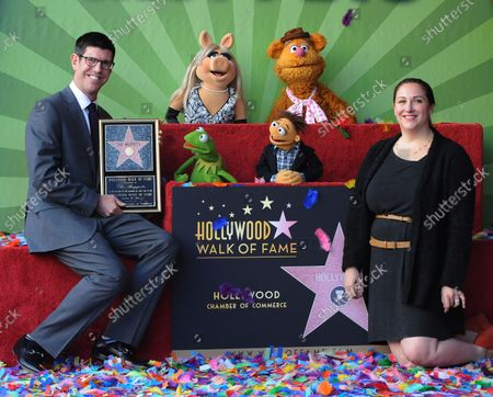 The Walt Disney Studios Chairman Rich Ross (L) and Lori MacPherson, EVP, Global Product Management - TWDS attend the Inimitable Muppets unveiling ceremony honoring The Muppets  with the 2,466th star on the Hollywood Walk of Fame in Los Angeles on March 20, 2012.